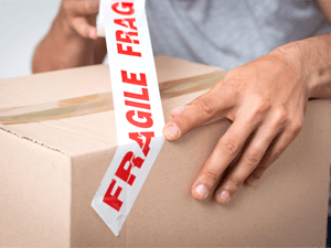 Cardboard box with fragile tape